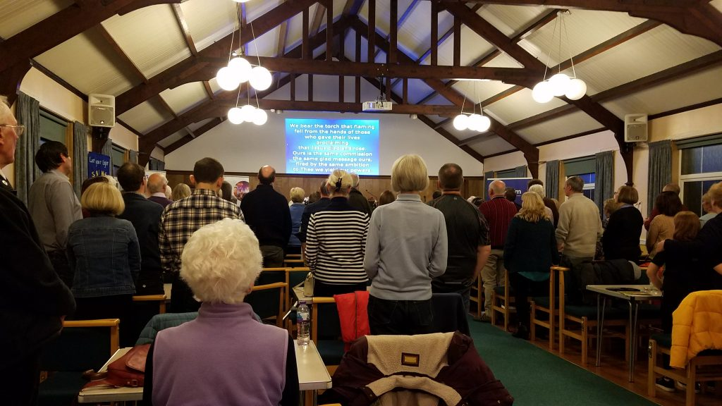 Mission Evening 2019 - congregation worship in song standing