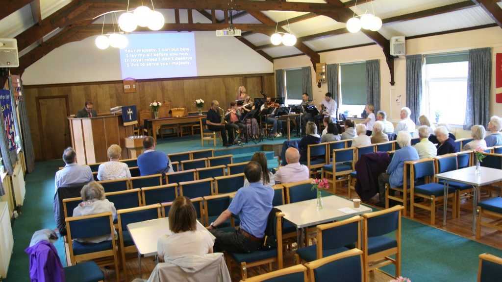 Sunday service in Sanctuary from back looking onto congregation and worship band