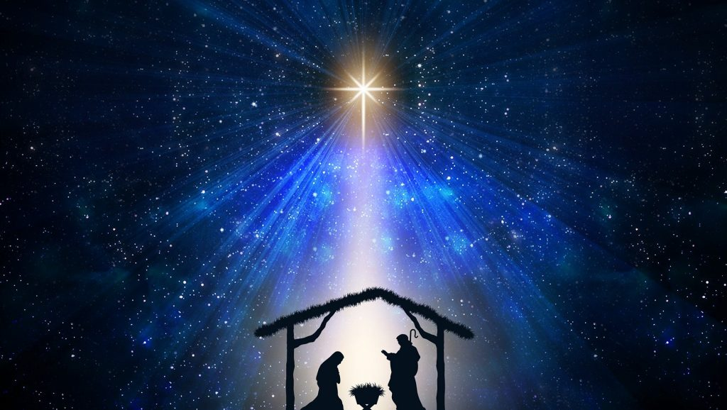 Night Nativity scene with star above stable