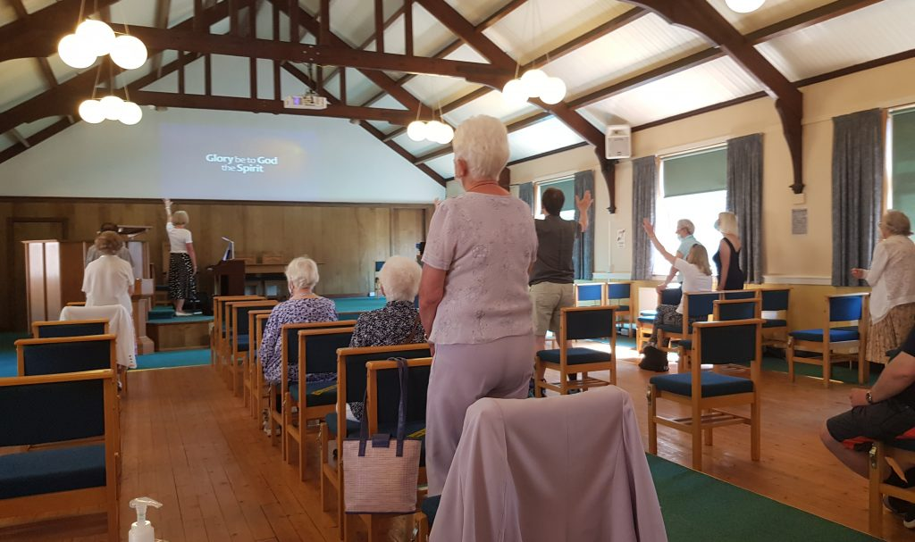 Sunday in building service of congregation from back of sanctuary