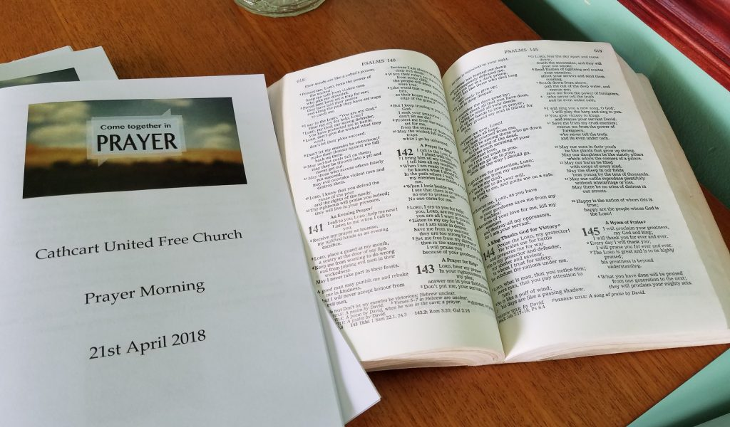 Prayer flyer with Bible open in Psalms